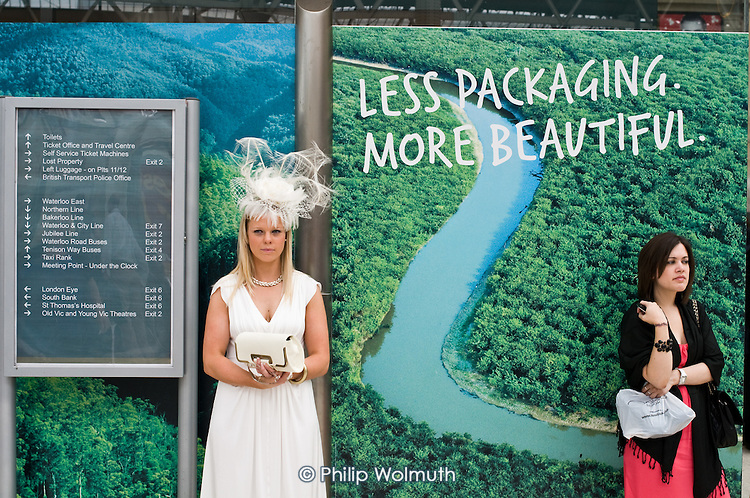 'Less packaging, more beautiful': two women wait at Waterloo station for a train to Ascot on Ladies Day at the racecourse.