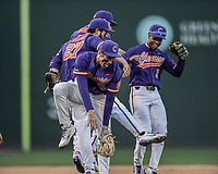 Third baseman Patrick Cromwell (25), center, of the Clemson Tigers jumps into the air as he celebrates the final out of a 5-1 win over the South Carolina Gamecocks in the Reedy River Rivalry game on Saturday, March 3, 2018, at Fluor Field at the West End in Greenville, South Carolina. (Tom Priddy/Four Seam Images)