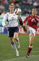 06 November,  2004.   USWNT forward Cindy Parlow (12) looks to avoid the ball kicked by Mariann Knudsen (2)at  Lincoln Financial Field in Philadelphia, Pa.