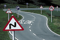 Bending European road showing problems, decisions and the  dangers of driving