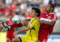 Chicago Fire defender C.J. Brown (2) clears the ball away from Columbus Crew forward Guillermo Barros Schelotto (7).  The Chicago Fire tied the Columbus Crew 0-0 at Toyota Park in Bridgeview, IL on July 11, 2009.