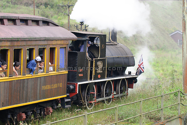 Engine driver reversing a historic steam train at Paranapiacaba station; near Sao Paulo, Brazil. In 1856 the British-owned Sao Paulo Railway Company was awarded the concession to operate a rail line between the port of Santos and Jundai, 70km north of Sao Paulo city, in what was then a developing coffee-growing region. The 139km line was completed in 1867, remaining under British control until 1947. Overcoming the near-vertical incline of the Serra do Mar that separates the interior of the state from the coast, the line was using the largest funicular system in the world and was regarded as an engineering miracle. --- No releases available.