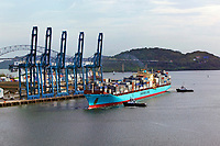aerial photograph of a loaded Maersk Lines containership at the Port of Balboa, being pulled from the dock for entry into the Panama Canal, Panama; the Bridge of the Americas is in the background | fotografía aérea de un buque portacontenedores de Maersk Lines cargado en el Puerto de Balboa, siendo sacado del muelle para entrar en el Canal de Panamá, Panamá; el Puente de las Américas está al fondo