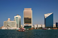 Dubai, United Arab Emirates. Dubai Creek and commercial waterfront offices, hotels, etc. National Bank of Dubai. Chamber of Commerce. Tour boats..