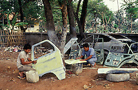 Indonesia. Java. Jakarta.  Roadside car re-building and re-cycling workshop.