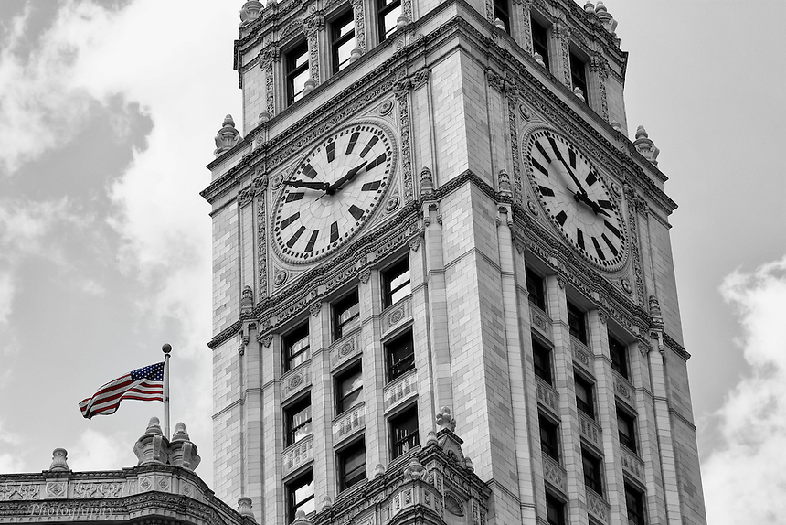 Looking up at the clock tower of the Wrigley Building in Chicago in B&W.