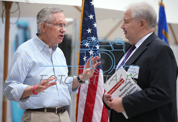 Senate Majority Leader Harry Reid talks to Russian Ambassador Sergey Kislyak following the 17th annual Lake Tahoe Summit conference at Sand Harbor, near Incline Village, Nev., on Monday, Aug. 19, 2013. The event, which brings representatives together from agencies around Nevada and California to protect Lake Tahoe, is of interest to Russia as it relates to thier Lake Baikal.<br /> Photo by Cathleen Allison