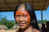Pará State, Brazil. Aldeia Pukararankre (Kayapo). Smiling woman with urucum and genipapo face paint.