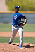 Chicago Cubs relief pitcher Yovanny Cruz (50) delivers a pitch to the plate during an Extended Spring Training game against the Colorado Rockies at Sloan Park on April 17, 2018 in Mesa, Arizona. (Zachary Lucy/Four Seam Images)