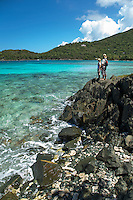 Two hikers on the rocks between Hawksnest Beach and Little Hawksnest Beach<br />