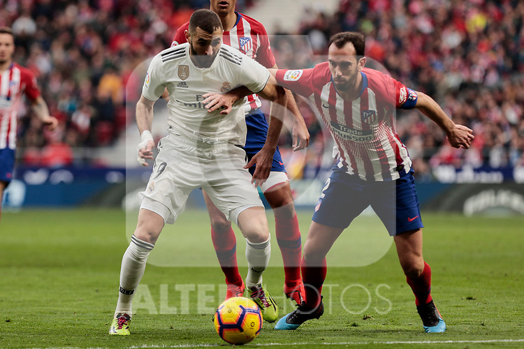 Atletico de Madrid's Diego Godin and Real Madrid's Karim Benzema during La Liga match between Atletico de Madrid and Real Madrid at Wanda Metropolitano Stadium in Madrid, Spain. February 09, 2019. (ALTERPHOTOS/A. Perez Meca)