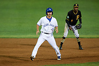 Bluefield Blue Jays pinch runner Cal Stevenson (19) leads off second base in front of Victor Ngoepe (5) during a game against the Bristol Pirates on July 26, 2018 at Bowen Field in Bluefield, Virginia.  Bristol defeated Bluefield 7-6.  (Mike Janes/Four Seam Images)
