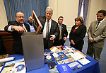 NV150 committee members place items in the NV150 time capsule at the Capitol, in Carson City, Nev., on Monday, Dec. 15, 2014. The capsule, containing 45 items related to the Sesquicentennial, is set to be opened in 2064.<br /> Photo by Cathleen Allison