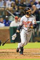 Baltimore Orioles outfielder Nick Markakis #21 runs to first base during the Major League Baseball game against the Texas Rangers on August 21st, 2012 at the Rangers Ballpark in Arlington, Texas. The Orioles defeated the Rangers 5-3. (Andrew Woolley/Four Seam Images).