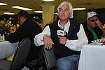 Bob Baffert looks to the heavens for inspiration before talking about the chances of Bodemeister in the Preakness at the Alibi Breakfast at Pimlico Race Course in Baltimore, Maryland  on May 17, 2012