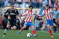 Atletico de Madrid's Oliver Torres (c) and Emiliano Insua (r) and Granada's Juanma Ortiz during La Liga match.April 14,2013. (ALTERPHOTOS/Acero)