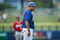 Kannapolis Cannon Ballers manager Guillermo Quiroz (40) argues a call with home plate umpire Zee Zdenek (not pictured) during the game against the Carolina Mudcats at Atrium Health Ballpark on June 10, 2021 in Kannapolis, North Carolina. (Brian Westerholt/Four Seam Images)