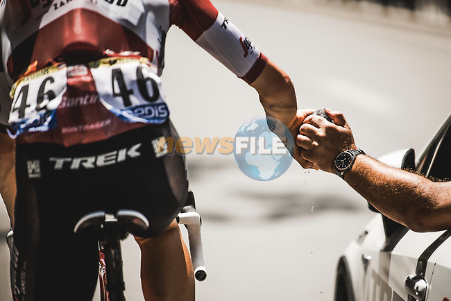 Latvian Champion Toms Skujins (LAT) Trek-Segafredo takes some food from the team car during Stage 16 of the 2021 Tour de France, running 169km from Pas de la Case to Saint-Gaudens, France. 13th July 2021.  <br /> Picture: A.S.O./Pauline Ballet | Cyclefile<br /> <br /> All photos usage must carry mandatory copyright credit (© Cyclefile | A.S.O./Pauline Ballet)
