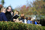18 October 2009: Fans pick favorites as horses tack up in Keeneland's scenic parade ring prior to the first race.