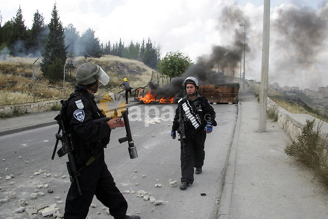 Palestinian youths hurl stones towards Israeli border policemen (not seen) in the East Jerusalem neighborhood of Silwan, on 13 May 2011. Riots broke out in several flashpoints in East Jerusalem following the Friday Prayers. Photo by Mahfouz Abu Turk
