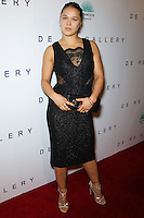 WEST HOLLYWOOD, CA, USA - OCTOBER 23: Ronda Rousey arrives at Brian Bowen Smith's First Solo Show 'Wildlife' held at the De Re Gallery on October 23, 2014 in West Hollywood, California, United States. (Photo by Celebrity Monitor)