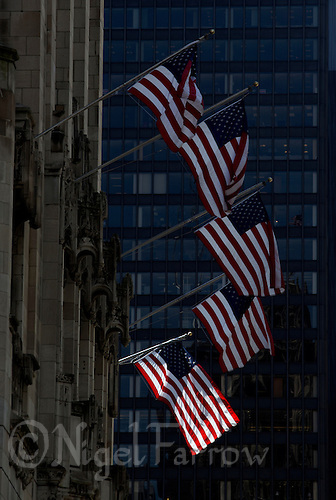 01 JUL 2014 - CHICAGO, USA - The Stars and Stripes, the flag of the USA, flies from the front of the Chicago Tribune building in the lead up to the July the 4th Independence Day celebrations in Chicago in the USA (PHOTO COPYRIGHT © 2014 NIGEL FARROW, ALL RIGHTS RESERVED)