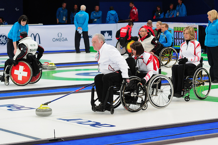 Jim Armstrong and Ina Forrest, Vancouver 2010 - Wheelchair Curling // Curling en fauteuil roulant.<br /> Team Canada competes in Wheelchair Curling // Équipe Canada participe en curlign en fauteuil roulant. 13/03/2010.