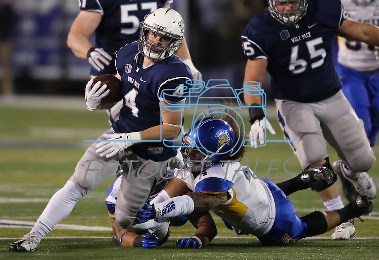 Nevada's Kendall Brock (4) breaks a San Jose State tackle during the first half of an NCAA college football game in Reno, Nev., on Saturday, Nov. 16, 2013.<br /> (AP Photo/ Cathleen Allison).