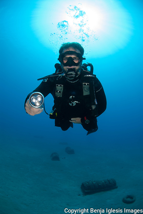 Diver with light at the south shore of Maui.Hawaii.