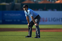Umpire Thomas Fornarola handles the calls on the bases during the South Atlantic League game between the West Virginia Power and the Greensboro Grasshoppers at First National Bank Field on August 9, 2018 in Greensboro, North Carolina. The Power defeated the Grasshoppers 5-3 in game one of a double-header. (Brian Westerholt/Four Seam Images)