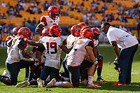 The Syracuse defense huddles on the field during a break in the action. The Pitt Panthers defeated the Syracuse Orange 44-37 in overtime at Heinz Field in Pittsburgh, Pennsylvania on October 6, 2018.