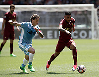 Calcio, Serie A: Roma, stadio Olimpico, 30 aprile 2017.<br /> AS Roma's Emerson Palmieri (r) in action with Lazio's Lucas Biglia (l) during the Italian Serie A football match between AS Roma an Lazio at Rome's Olympic stadium, April 30 2017.<br /> UPDATE IMAGES PRESS/Isabella Bonotto