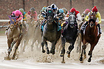 LOUISVILLE, KY - MAY 06: The field exits the fourth turn during the Churchill Downs Stakes on Kentucky Derby Day at Churchill Downs on May 6, 2017 in Louisville, Kentucky. Limousine Liberal #9, ridden by Jose Ortiz (black and white cap), won the race. (Photo by Mary Meek/Eclipse Sportswire/Getty Images)