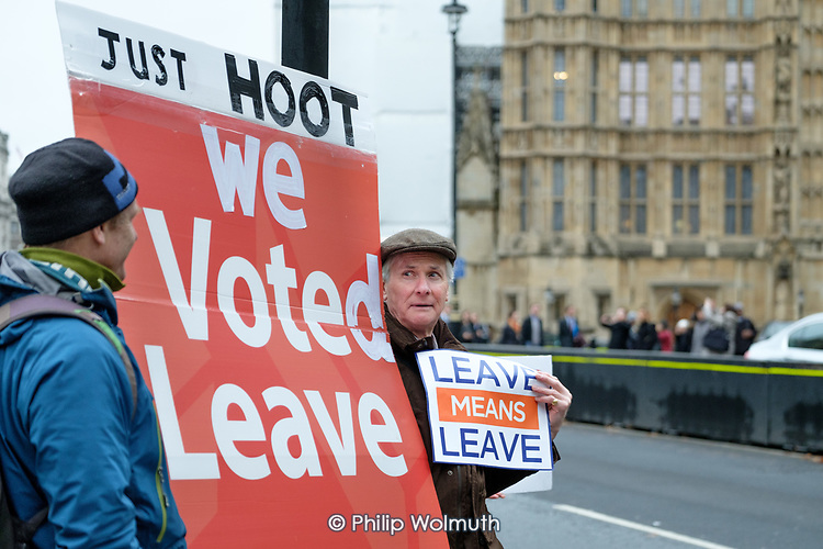 Leave Means Leave.  Pro-Brexit protesters demonstrate outide the Houses of Parliament as MPs debate the government's Brexit deal, Westminster, London.