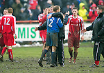 Brechin v St Johnstone....12.03.11  Scottish Cup Quarter Final.Jim Weir gets a hug from ex-team mate Steven Anderson at full time.Picture by Graeme Hart..Copyright Perthshire Picture Agency.Tel: 01738 623350  Mobile: 07990 594431