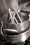 Stainless steel kitchen equipment–bowl, stock pot, whisk, utensils.