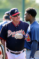 Special instructor Lee Elia of the Atlanta Braves farm system talks with Mykal Jones in a Minor League Spring Training intrasquad game on Wednesday, March 18, 2015, at the ESPN Wide World of Sports Complex in Lake Buena Vista, Florida. (Tom Priddy/Four Seam Images)