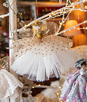 BNPS.co.uk (01202 558833)<br /> Pic: PhilYeomans/BNPS<br /> <br /> Each hand crafted fairy is unique.<br /> <br /> Fairy Grandmother - Bespoke fairy maker Dinah Nicholson gets a helping hand from grandchildren Franka, Carla and Daisy this Christmas...<br /> <br /> Described as a 'Living National Treasure' by Country Life magazine her unique creations have even been supplied as wedding gifts for the bridesmaids at Royal weddings.<br /> <br /> Each of her 4159 creations so far have been logged in a fairy ledger, and the £60 cost has never been increased as 'I want everyone to be able to afford one'.
