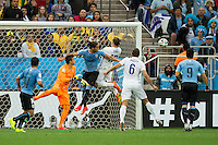 Wayne Rooney of England heads the ball on to the bar