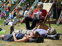 HOT AND SUNNY WEATHER PICTURE WALES<br />Hay on Wye. Friday 03 June 2016<br />A woman rests on the festival green reading a book at the Hay Festival, Hay on Wye, Wales, UK