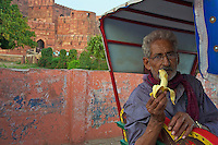 A Rickshaw driver Having a break Agra Fort India