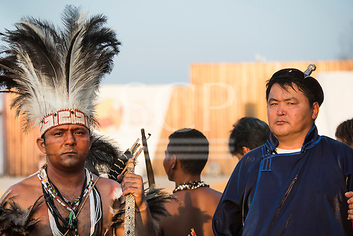 A Brazilian indienous chief and a Mongol competitor wait to take part in the International Indigenous Games, in the city of Palmas, Tocantins State, Brazil. Photo © Sue Cunningham, pictures@scphotographic.com 24th October 2015