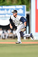 Columbia Fireflies third baseman Luis Ortega (35) reacts to play during a game against the Asheville Tourists at McCormick Field on June 18, 2016 in Asheville, North Carolina. The Tourists defeated the Fireflies 5-4. (Tony Farlow/Four Seam Images)