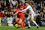 Marcos Llorente of Real Madrid (R) fights for the ball with Pablo Sarabia Garcia of Sevilla FC (L) during La Liga 2017-18 match between Real Madrid and Sevilla FC at Santiago Bernabeu Stadium on 09 December 2017 in Madrid, Spain. Photo by Diego Souto / Power Sport Images