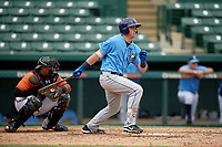 Tampa Bay Rays first baseman Brendan McKay (38) hits a single in front of catcher Jean Carrillo (75) during an Instructional League game against the Baltimore Orioles on October 5, 2017 at Ed Smith Stadium in Sarasota, Florida.  (Mike Janes/Four Seam Images)