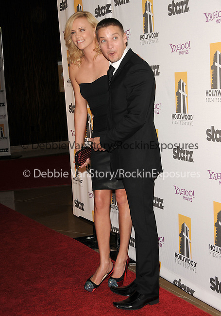 Charlize Theron & Jeremy Renner at The 13th Annual Hollywood Awards Gala held at The Beverly Hilton Hotel in Beverly Hills, California on October 26,2009                                                                   Copyright 2009 DVS / RockinExposures