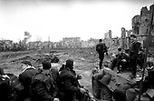 Grozny, Chechyna.1995.Russian Interior Ministry troops sit atop their APCs in the center of Grozny as teams of demolition experts explode massive amounts of unspent ammunition found in the buildings.