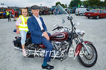 At the Paudie Fitzmaurice Tractor Run in Castleisland on Sunday, l to r: Little Ella Curtin Joyce from Castleisland taking Michael Healy Rae TD for a ride on his motorbike.