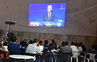 Tunisian People are watching the Debat of second round of the  presidential between  <br /> candidates Kais Saied (L), 61, an independent conservative academic, and business tycoon Nabil Karoui (R),on October 11, 2019 in Tunis.