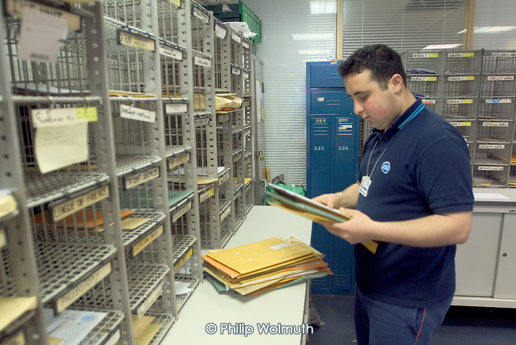 A porter in the post room at Homerton Hospital, Hackney, east London, where threatened industrial action by UNISON members employed by multinational ISS Mediclean in catering, portering and cleaning services lead to a deal which took pay from £4.43 to £5.00 an hour (£5.35 from 1 April 2004),  improved annual leave and the introduction of an occupational sick pay scheme.  The claim was part of the Living Wage campaign carried out in partnership with the East London Citizens Organisation (TELCO).